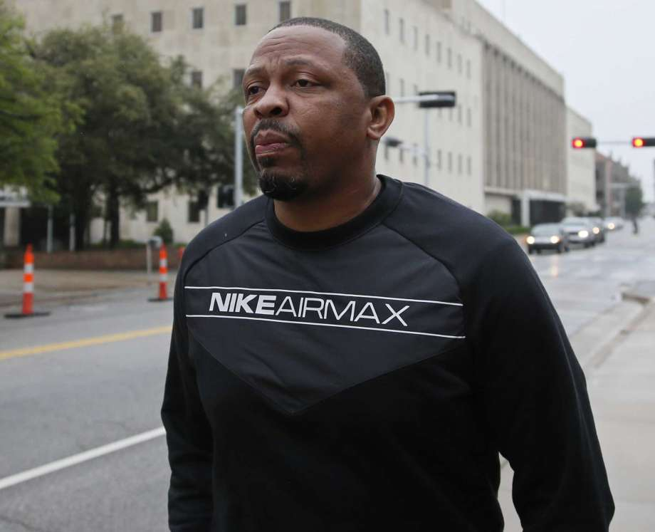 Lamont Evans an assistant basketball coach at Oklahoma State University leaves the federal courthouse following a court appearance in Oklahoma City Wednesday Sept. 27 2017. Evans is facing federal charges in conjunction with a wide probe of fraud and