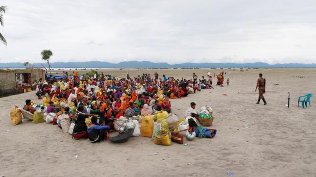 Rohingya refugees wait at a Border Guard Bangladesh post after crossing the Bangladesh Myanmar border by boat through the Bay of Bengal in Shah Porir Dwip. Reuters