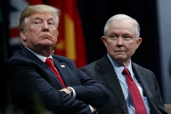 President Donald Trump sits with Attorney General Jeff Sessions during the FBI National Academy graduation ceremony in Quantico Va