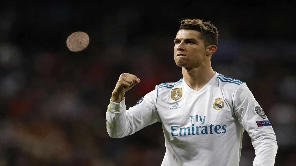Real Madrid's Cristiano Ronaldo celebrates at the end of a Champions League quarter final second leg football match against Juventus at the Santiago Bernabeu stadium in Madrid Wednesday