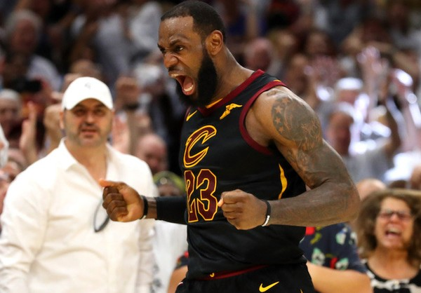 LeBron James of the Cleveland Cavaliers reacts after a basket in the fourth quarter against the Boston Celtics during Game 6 of the 2018 NBA Eastern Conference Finals at Quicken Loans Arena