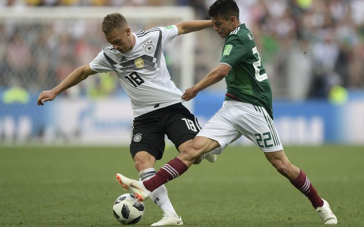 Germany's Joshua Kimmich and Mexico's Hirving Lozano compete for the ball