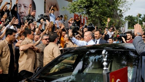 Turkish President Tayyip Erdogan waves to supporters as he leaves his residence in Istanbul Turkey