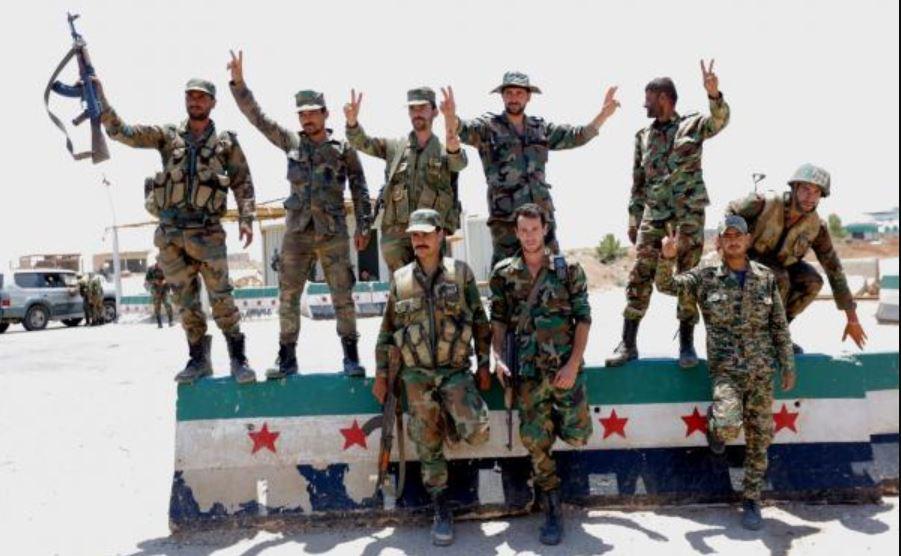 Syrian forces reach Jordanian border crossing as rebels negotiate surrender
