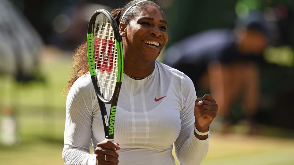 Serena Williams celebrates after winning against Camila Giorgi during their Wimbledon quarter-final encounter