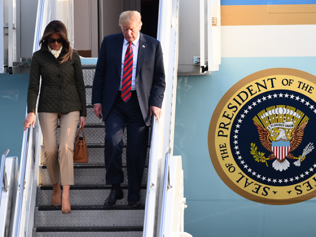 US President Donald Trump disembarks Air Force One with US First Lady Melania Trump at Prestwick Airport south of Glasgow
