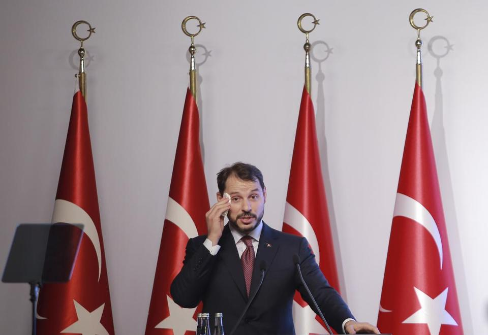 Berat Albayrak Turkey's Treasury and Finance Minister wiped his forehead as he spoke during a news conference in Istanbul Friday