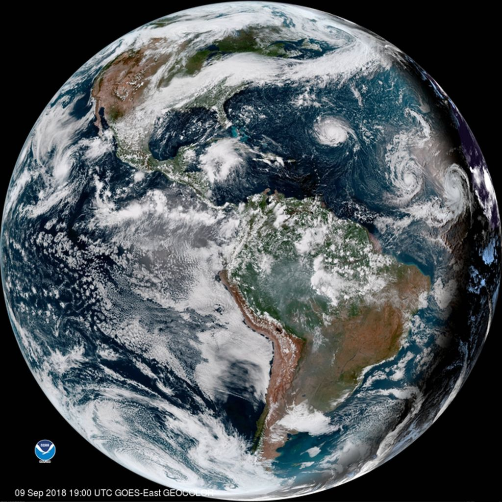 An enhanced satellite image showing Hurricane Florence third from right west of Isaac and Helene