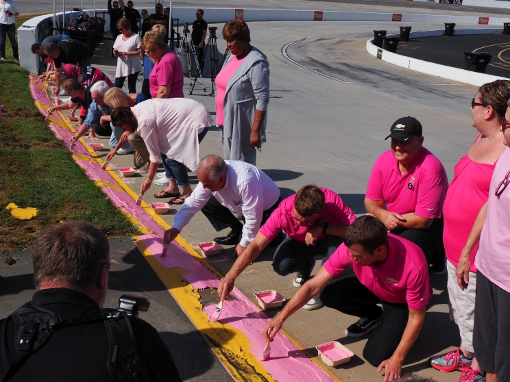 Jamie Mc Murray and Kasey Kahne Join Breast Cancer Survivors to Paint Martinsville's Curbs Pink