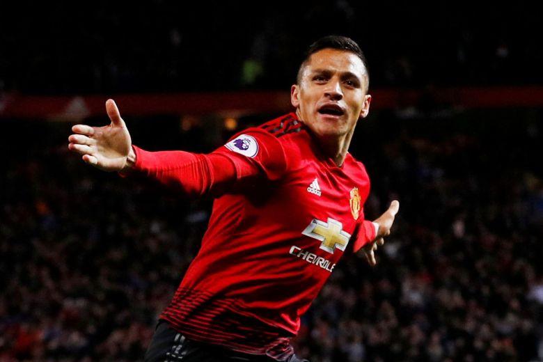 Manchester United's Alexis Sanchez celebrates scoring their third goal
